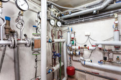 Heating pipes system. Pipes in a basement of a heating system royalty free stock photos
