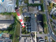 Heating plant with high chimney in city area, aerial view.  royalty free stock images