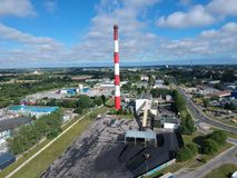 Heating plant with high chimney in city area, aerial view.  stock images