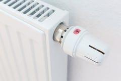 Heating radiator against white wall Stock Photo