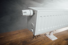 Heating radiator at home with warm steam Stock Photography