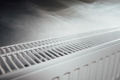 Heating radiator at home with warm steam Royalty Free Stock Photo