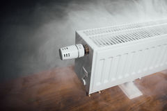 Heating radiator at home with warm steam Royalty Free Stock Photos