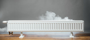 Heating radiator at home with warm steam Stock Image