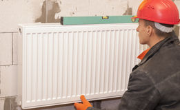 Heating radiator installation Royalty Free Stock Image