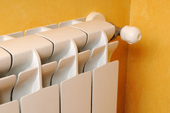 Heating radiator lateral view. White aluminum heating radiator lateral view Stock Image