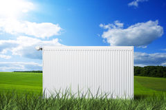 Heating radiator on meadow. Heating radiator with thermostat on meadow Royalty Free Stock Photography