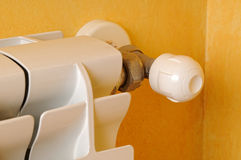 Heating radiator regulator detail. White aluminum heating radiator regulator detail Stock Photography