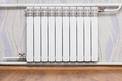 Heating radiator in room Stock Images
