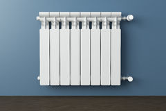 Heating radiator in a room with laminated wooden floor Stock Images