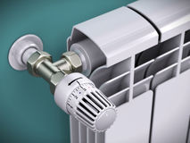 Heating radiator with thermostat Stock Photos