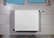 Heating radiator under window Royalty Free Stock Photos
