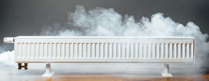 Heating radiator with warm steam Stock Photography