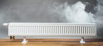 Heating radiator with warm steam Stock Photo