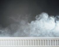 Heating radiator with warm steam Stock Image