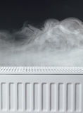 Heating radiator with warm steam Royalty Free Stock Photos