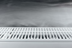 Heating radiator with warm steam Royalty Free Stock Photography