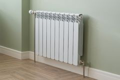 Heating Radiator, White radiator in an apartment.  stock image