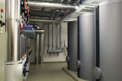 Heating stoves and pipe infrastructure. In boiler room Royalty Free Stock Photos