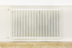 Heating system attached to a wall Stock Image