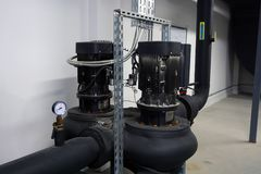 Powerful pumps. Heating system in a boiler room. Powerful pumps stock photos