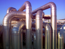 Heating system Pipeline. Tubes used to distribute the hot water in a heating plant Royalty Free Stock Photos
