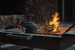 Heating the tea over the fire. Preparing tea in Bedouin camp in the desert Stock Image