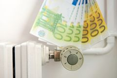 Heating thermostat with euros, expensive heating concept. An heating thermostat with euros, expensive heating concept Stock Image