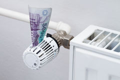 Heating thermostat with money Royalty Free Stock Photos