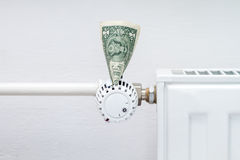 Heating thermostat with money Stock Photos