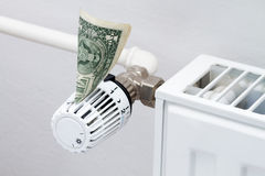 Heating thermostat with money Royalty Free Stock Image