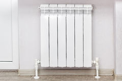Heating white radiator radiator. Royalty Free Stock Images