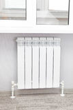 Heating white radiator radiator. Stock Image