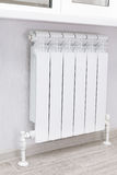 Heating white radiator radiator. Royalty Free Stock Photo