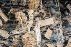 Heating wood in a sack prepared for the winter. Large wood blocks in a sack Royalty Free Stock Photo