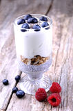 Heatlhy breakfast. Chia seeds base, layered with granola, yogourt and fresh blueberries stock images