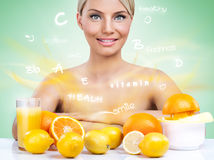 Heatlhy woman with citrus fruits Stock Photo