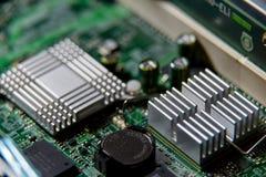 Heatsink closeup on the computer motherboard. Selective focus Stock Photos