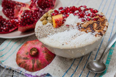 Heavegan banana smoothie with pomegranate, mulberry, coconut, Chia, carob. Raw fruit energy food. Royalty Free Stock Photography