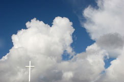 Heaven. White cross against sunny clouds Stock Image