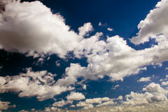 Heaven and clouds. Dark blue heaven and grey-white clouds stock photo