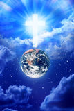 Heaven Cross Earth Religion God. The earth with a glowing cross in heaven royalty free stock images