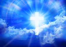 Heaven Cross Sky Religion Background. A glowing cross in the blue sky with shafts of light, clouds and stars royalty free stock image
