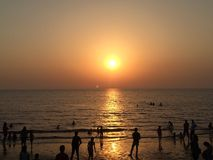 Heaven in evening. A good place near Navsari , called dandi . People enjoy # sun is going down # unbelievable secne # peace # enjoy # love to capture natural stock image