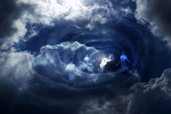Heaven gate. Tunnel in the sky with clouds and some men. Many metaphorical uses Royalty Free Stock Image
