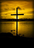 Heaven is golden. This cross is standing on the beach of lake Siljan in Dalecarlia, Sweden Stock Photos