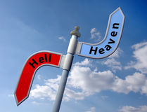 Heaven or hell. Sign post with direct to heaven or hell Stock Image