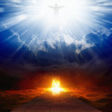 Heaven and hell. Jesus Christ in blue sky with clouds, bright light from heaven, burning doorway in dark red sky, road to hell, way to hell, heaven and hell Royalty Free Stock Images