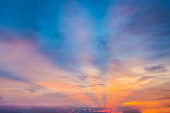 Heaven light ray from sun behind cloud in the blue sky. Thai Royalty Free Stock Photography