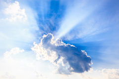 Heaven light from sun behind clouds Stock Images